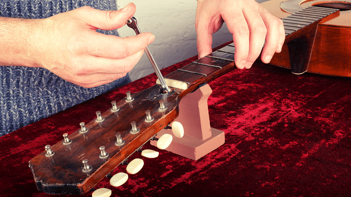 truss rod adjustment of an acoustic guitar